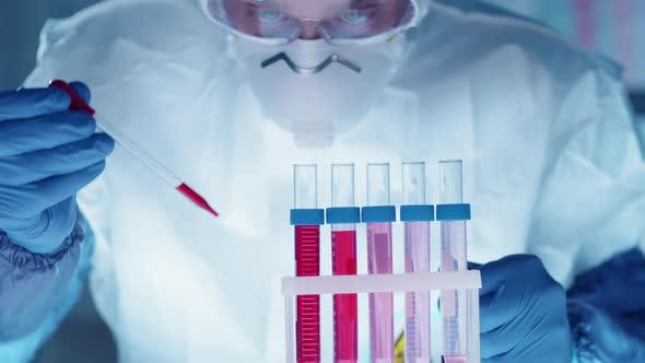 Thumbnail for Male Scientist in Protective Suit Conducting Research in Lab