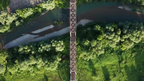 Train Moving on Bridge Above a River