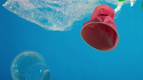 Plastic Glasses and Bottles in Ocean Water Pollution Concept