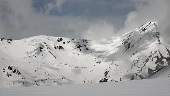 Thumbnail for High Altitude Rocky Snowy Mountain Ridge in Sunny Day