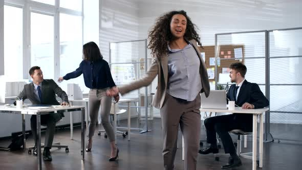Thumbnail for Happy Business People Dancing in Office