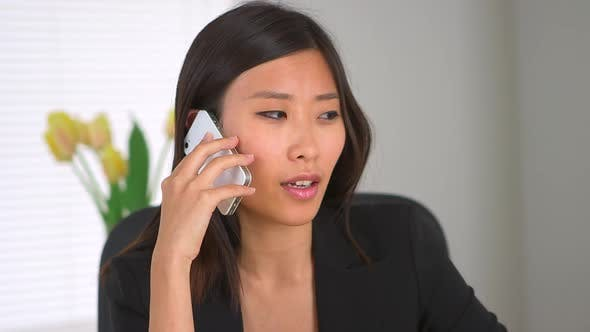 Chinese businesswoman talking on smartphone
