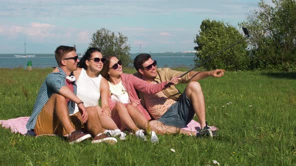 Cover Image for Friends Taking Picture By Selfie Stick in Summer 29