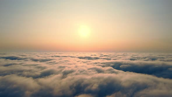 Thumbnail for Flying Over the Clouds at Sunset. The Sun Rises Over the Fog. Orange Sunset Over the Fog.