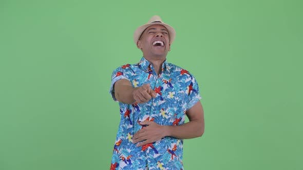 Cover Image for Happy Multi Ethnic Tourist Man Laughing and Pointing at Camera