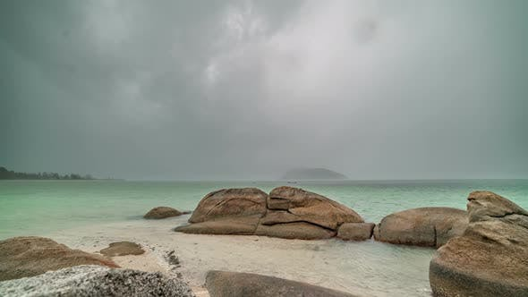 Cover Image for Storm with Heavy Tropical Rain on the Background of Rocky Stones and Sea Landscape