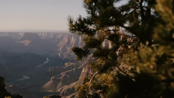 Thumbnail for Beautiful Background Shot Revealing Amazing Colorado River and Sunset Mountains View of Epic Grand