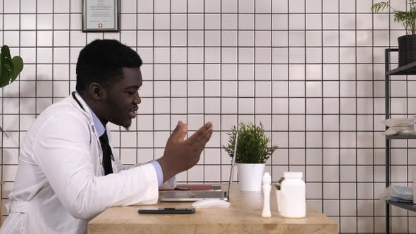 Thumbnail for Afro American Doctor Talking with Patient Online Video