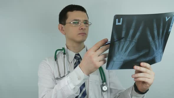 Thumbnail for Doctor Looks At X Ray