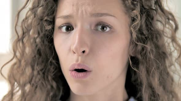 Face Close Up of Amazed Curly Hair Woman