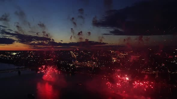 Aerial Colorful Fireworks in Night City Sky Bright Holiday Celebrations Party