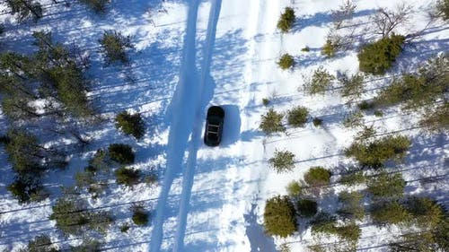 Black Suv Car Driving In Winter Snow Country Road 2