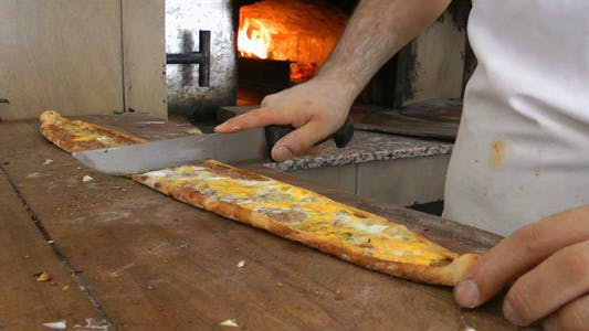 Thumbnail for Cutting Turkish Pizza