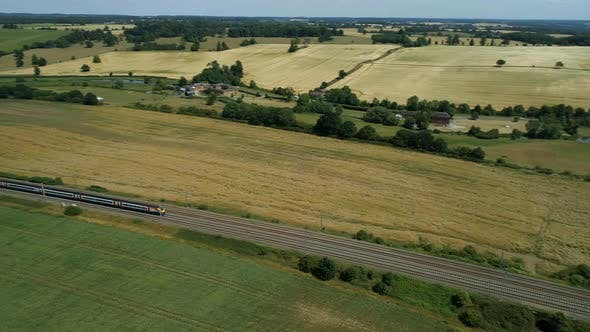High Level View of a Fast Commuter Train in the Countryside