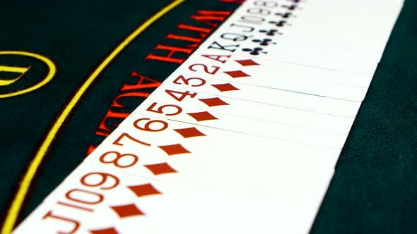 Thumbnail for Playing Cards Are Spread Out on Poker Table, Close Up
