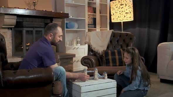 Thumbnail for Father and Daughter Spending Leisure Time Near the Fireplace in the Living Room