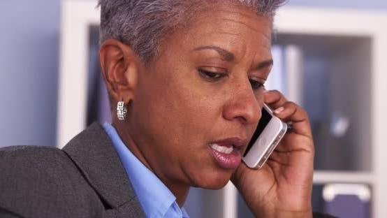 Thumbnail for Senior Black businesswoman talking on smartphone