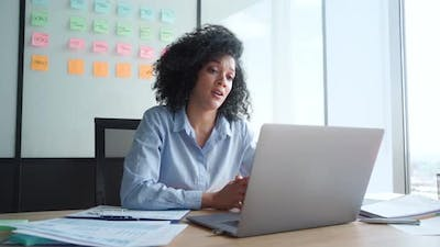 African American Businesswoman Having Working Video Call in Office