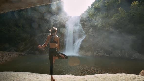 Thumbnail for Girl Stands in Yoga Position Against River Sun Rays
