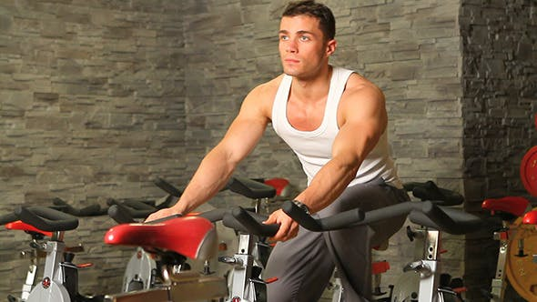Thumbnail for Handsome Sporty Man Is Exercising In Gym Centre