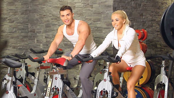 Thumbnail for Sporty Couple Exercising At Gym Centre