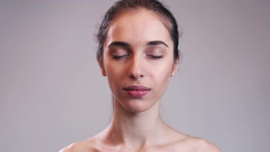 Thumbnail for Portrait Of Naked Girl Opening Eyes