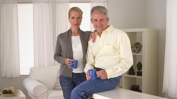 Thumbnail for Portrait of senior couple in living room