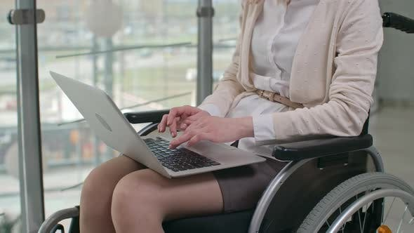 Cover Image for Handicapped Businesswoman Using Laptop