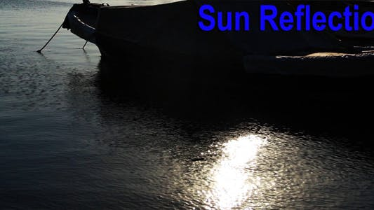 Thumbnail for Boat And Sun Reflection