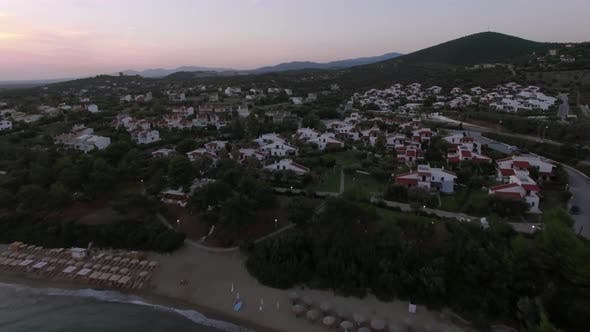 Thumbnail for Aerial Shot of Seaside and Villas of Trikorfo Beach, Greece
