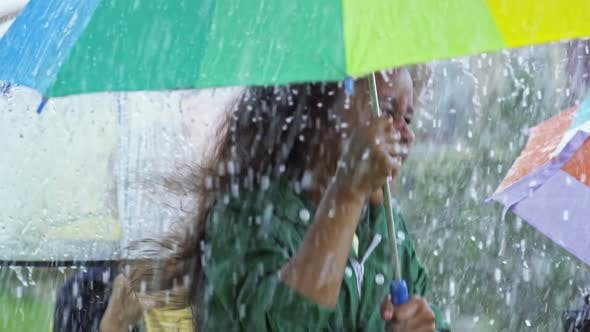 Thumbnail for Laughing Children Jumping in Rain