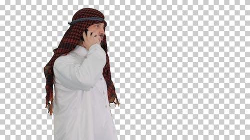 Arabian Sheikh businessman making a call, Alpha Channel