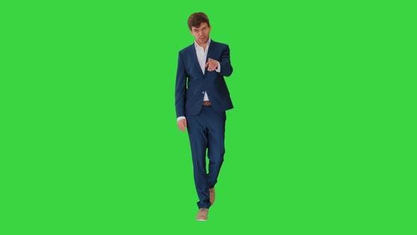 Businessman Walking and Explaining Something To Camera on a Green Screen, Chroma Key