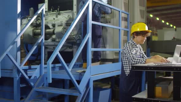 Thumbnail for Female Technician at Factory Production Line