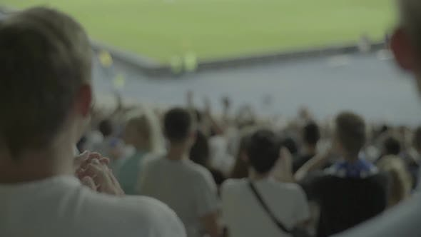 Fans at the Stadium During the Match. Slow Motion.