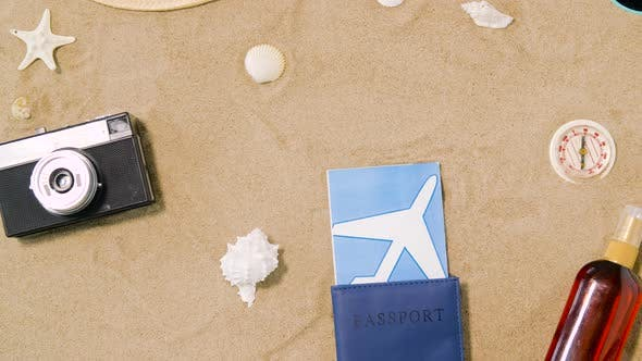 Thumbnail for Travel Tickets, Camera and Hat on Beach Sand