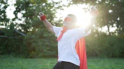 Fat super hero kid dancing in garden
