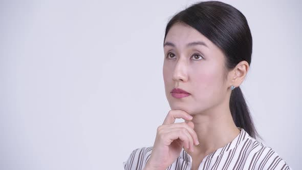 Thumbnail for Face of Happy Beautiful Asian Businesswoman Thinking