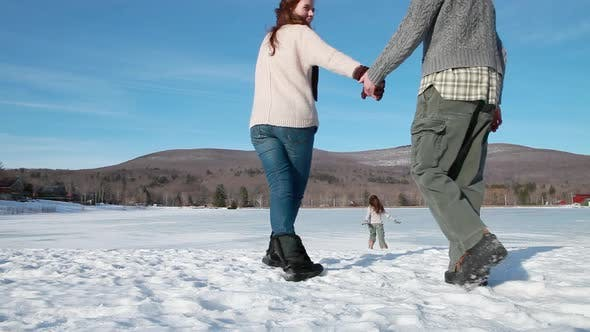 Thumbnail for Family walking in the snow