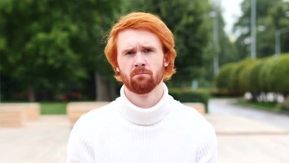 Thumbnail for Portrait of Sad Man with Red Hairs, Outdoor