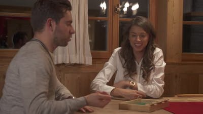 A man and woman couple lifestyle playing a board game.