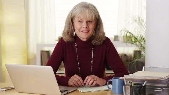 Thumbnail for Senior woman smiling laptop computer