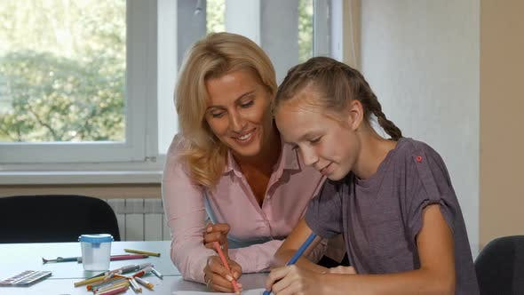 Thumbnail for Mature Beautiful Woman Enjoying Drawing with Her Little Student