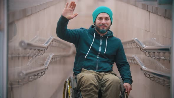 Thumbnail for Disabled Man in Wheelchair Smile Waving His Hand, Showing Encouraging Gestures