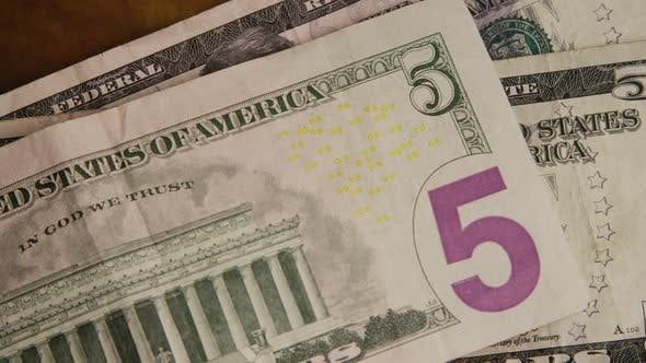 Rotating shot of American money (currency) - MONEY 444
