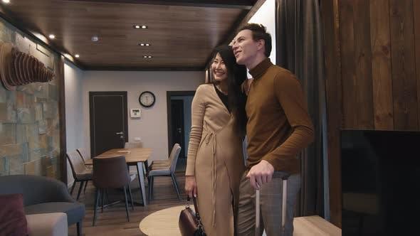 Multi-Ethnic Couple In Hotel Room
