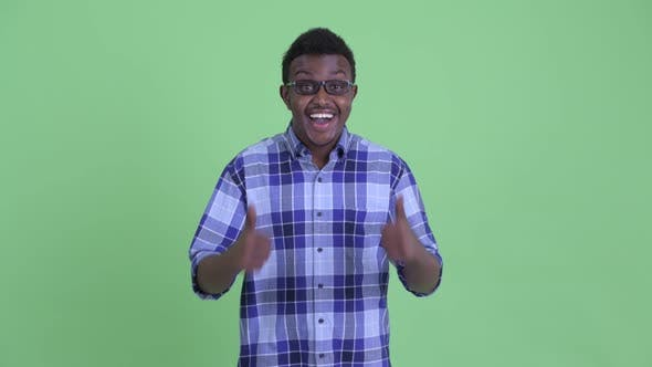 Thumbnail for Happy Young African Hipster Man Giving Thumbs Up and Looking Excited