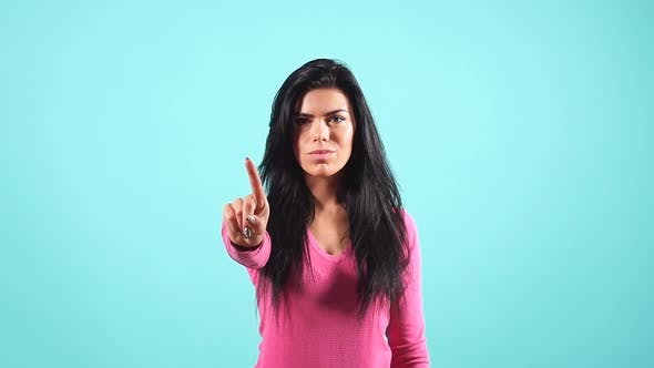 Thumbnail for Cheerful Beautiful Brunette Girl Is Preventing a Mistake. Warning Gesture