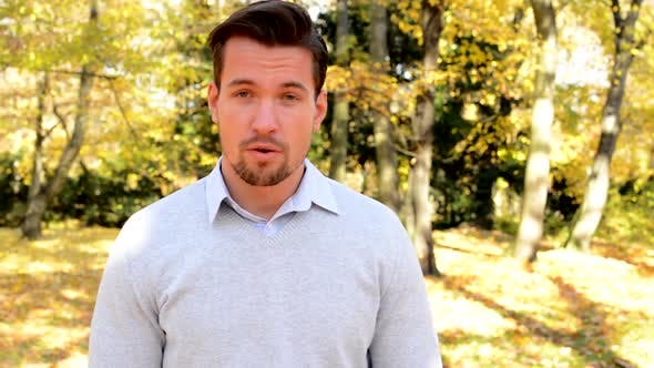 Thumbnail for Young  Man Stands in the Woods, Talks and Nodds His Head Approvingly