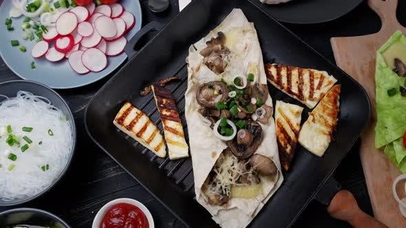 Assortment of Street Food on a Dark Wood Table